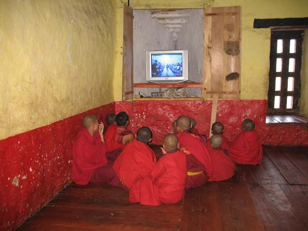 Young monks watching TV
