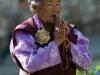 Old woman praying at Memorial Chorten