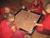 Monks playing carom (board game)